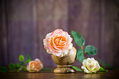small bouquet of beautiful pink roses on a wooden table
