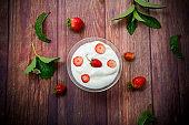 sweet homemade yogurt with red ripe fresh strawberries