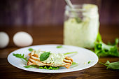 green bread spread of arugula, curds and eggs with fried toast