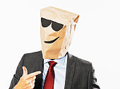 Cool businessman wearing sunglasses makes a positive gesture