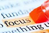 """The word """"focus"""" is highlighted in orange on document"""