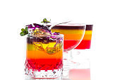 Sweet multi-colored fruit puff jelly in a glass cup