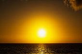 Spectacular golden sunset over calm ocean