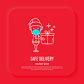 Safety delivery of Christmas gift. Elf in surgical mask holding gift box. Christmas in new normal. Thin line icon, vector illustration.