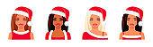 Asian, Indian and European girls wearing Santa Claus hats