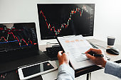 Business Man working Investment and Entrepreneur Trading Stock Market and Exchange discussing and analysis graph.