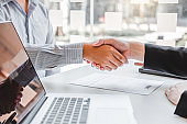 Business Shaking hands greeting new colleagues after during job interview Concept