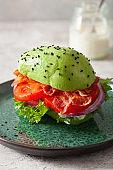 keto paleo diet avocado burger with bacon, lettuce, tomato