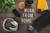 work from home text desk with keyboard computer smartphone notebook houseplants, workspace office at home