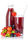Berry smoothie fruit juice drink wild berries glass and bottle isolated on white