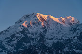 Red morning sunrise light over Annapurna south mountain peak view from Mardi Himal trekking route, Himalaya mountains range in Nepal
