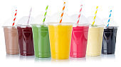 Juice collection of fruit smoothies fruits milkshake orange juices straw drinks in cups isolated on white