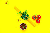 Various uncooked pasta on yellow background. Food concept. Top view, close-up