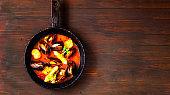 Mussels in red curry sauce on wooden background.The concept of  healthy and satisfying appetizer  meal