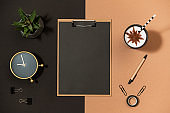 Mockup paper clipboard on office table top view