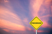 Yellow transportation sign with word preorder on violet sky background