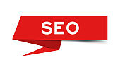 Red color paper speech banner with word SEO (Abbreviation of search engine optimization) on white background