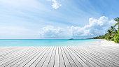 Empty wooden platform beside beautiful tropical island beach
