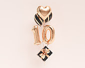 10 years old. Gold balloons number 10th anniversary, happy birthday congratulations. 3d rendering.
