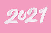 Creative New year 2021 smeared cream mark. White paint numeral 2021 on pink background. 3D rendering