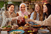 Lunch. Young Women In Cafe Portrait. Group Of Smiling Multiethnic Girls Cheering With Cocktails. Friends Meeting In Restaurant As Part Of Lifestyle.