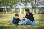Mother and toddler boy celebrating mother's day during coronavirus, covid 19 quarantine