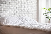 bed with white pillow and blanket with natural light in bedroom in the morning,bed and Cozy Bedroom Concept
