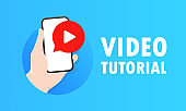 Video tutorial. Hand holds smartphone with play button. Video content marketing concept. Video conference and webinar. Online learning and training.