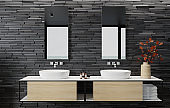 Luxurious apartment bathroom interior with large panoramic window and back wall slate stone.