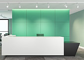 Modern green office interior with big white desk with copy space