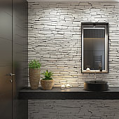 Luxurious modern home spa bathroom with matte white stacked stone wall and squared black matte mirror