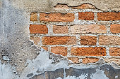 Abstract damaged old brick wall background