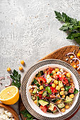 Chickpea salad on a gray background top view
