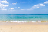 Peaceful beach with blue sky and blue sea, relaxing by the beach