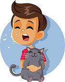 Sneezing Boy Having Cat Allergy Holding Kitten