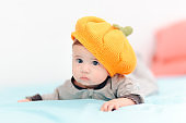 Funny Baby Girl Wearing Knitted Pumpkin Hat
