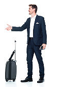 Caucasian male business person standing in front of white background wearing smart casual and holding briefcase