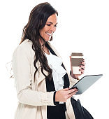 Caucasian young women businesswoman wearing businesswear and holding purse and using digital tablet