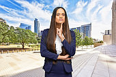 African-american ethnicity young women manager standing who is outdoors wearing businesswear