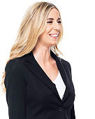 Caucasian female businesswoman standing in front of white background