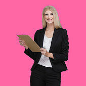Caucasian young women businesswoman standing in front of colored background and holding clipboard