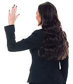 Caucasian female businesswoman standing in front of white background wearing businesswear