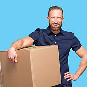 Caucasian male delivery person standing and holding container