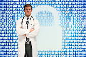 Young male expertise wearing lab coat and using computer