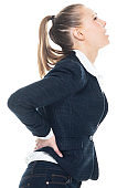 Caucasian female business person bending over wearing blazer
