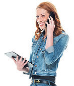 Caucasian female wearing denim jacket and using touch screen