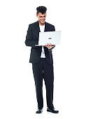 African-american ethnicity young male businessman standing wearing business casual and using laptop