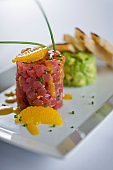Tuna tartare. Classic American restaurant or bistro appetizer classic. Sushi grade ahi tuna, diced, mixed w/ eggs, red onions, olive oil, lemon juice, garlic & capers. Served w/ garlic bread.