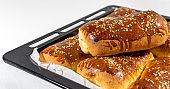 Fresh baked Turkish pastry in a oven tray, close-up