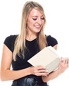 Caucasian female university student standing wearing businesswear and holding textbook